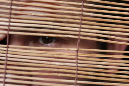 eyes looking through the blinds