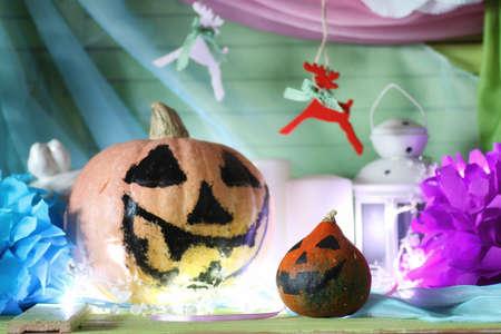pumpkin head face and light garland Stock Photo