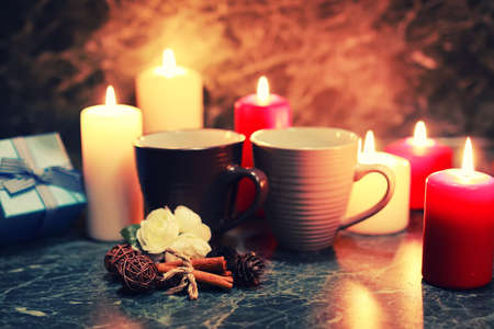night table with mug and candle Stock Photo