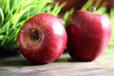 Red fresh apple on a wooden textured kitchen table Stock Photo