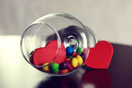 glass with candy pill