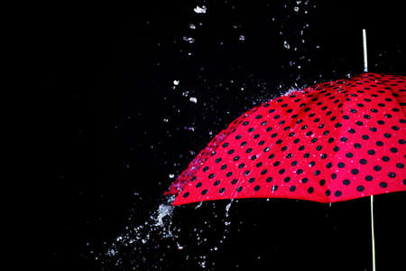 Rain drops on an umbrella isolated on the black background