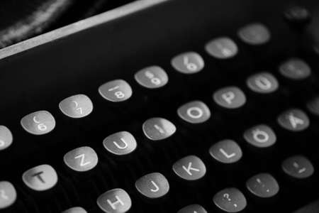 qwerty: Keys with letters of the English language on an old typewriter