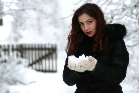 Beautiful girl in winter snowy day Stock Photo