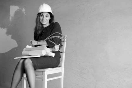monochrome photo of a business woman sitting on chair associated Stock Photo