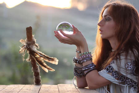 witch with crystal ball at sunset Stock fotó - 89427154