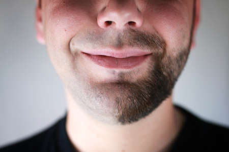 A portrait of a half shaven bearded man smiling Stok Fotoğraf