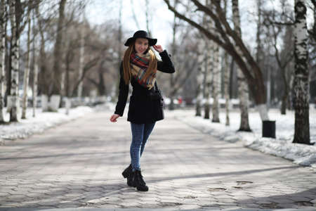 French woman for a walk in early spring