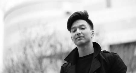 Black White photo of Asian young man outdoors posing