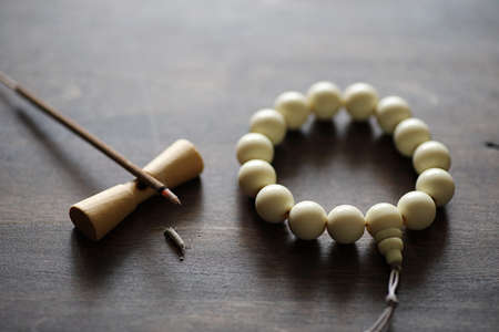 pipal: Beads and Incense on wooden table Stock Photo