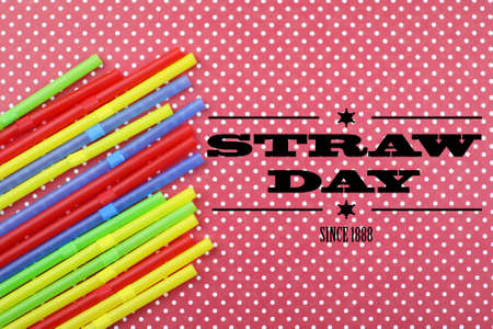 wordwide: cocktail tubes lie on a bright color background with straw day Stock Photo