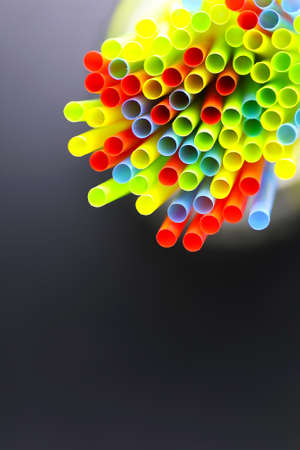 wordwide: colored plastic cocktail tubes standing in a glass Stock Photo