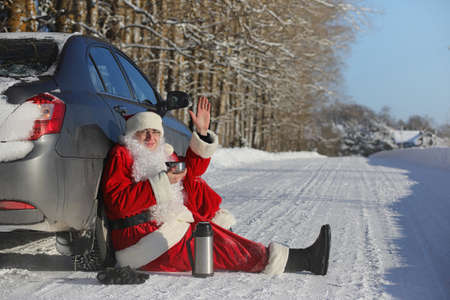 Santa Claus comes with gifts from the outside. Santa in a red suit