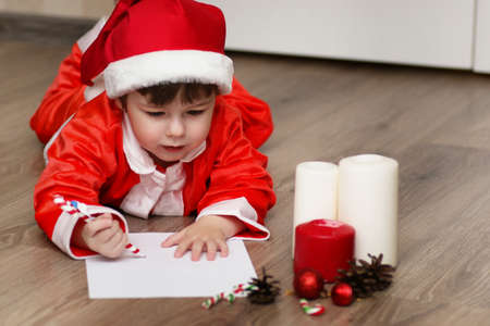 Little kid are writing letter to Santa
