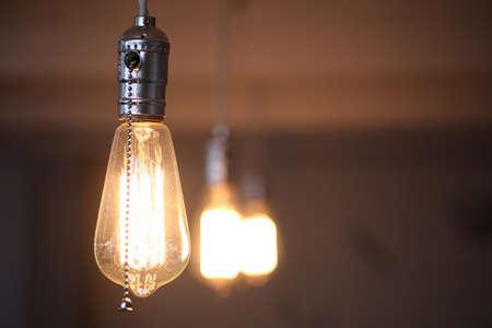 Lamps with tungsten filament. Edisons light bulb. Filament fila