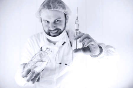Black and white photo of  bearded doctor in white coat and an ol