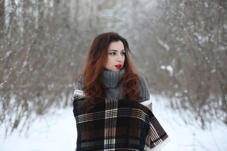 Beautiful girl in a beautiful winter park