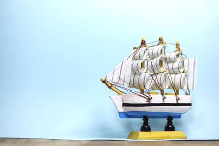 Old wooden ship with sails and masts toy on a stand. Vintage and retro toys