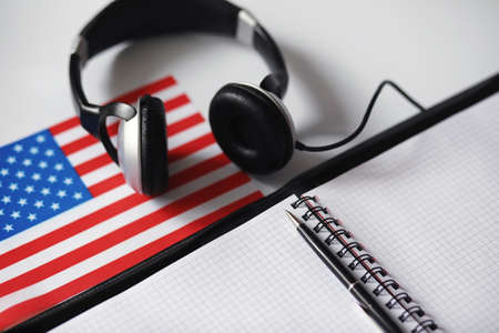 Learning foreign languages. Notepad for entries and a flag. Lang Stock Photo