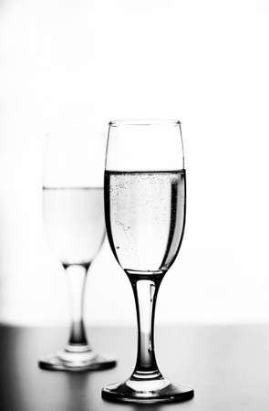 monochrome photo of champagne on white table on white background Stock Photo