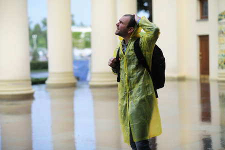 A man in a raincoat on a rainy day Stock Photo