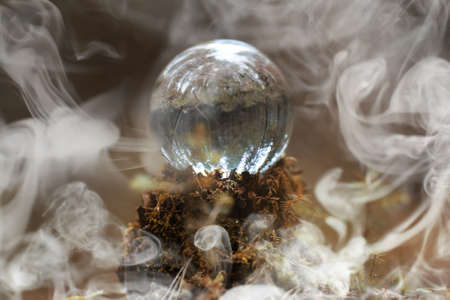 A crystal ball in the smoke. A magical accessory in the woods Stock Photo