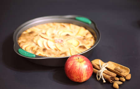 Preparation of apple pie at home. Homemade pastries with apples and nuts. Sweet dessert apples baked.