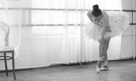 Young ballet dancer on a warm-up. The ballerina is preparing to