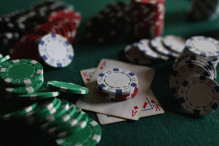 Poker chips and cards on the cloth Stock Photo