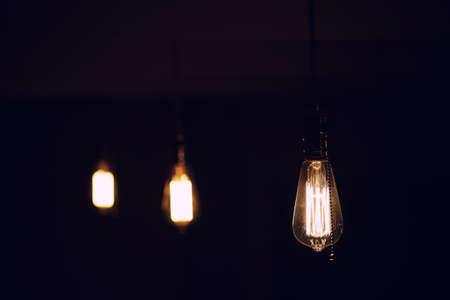 Lamps with tungsten filament. Edisons light bulb. Filament fila