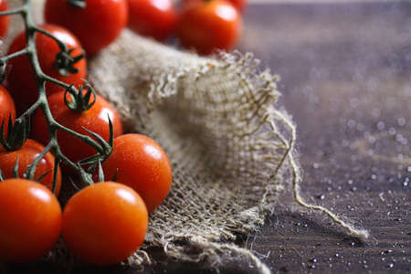 Branch with fresh cherry tomatoes. Ripe red tomatoes. Tomatoes a Stock fotó