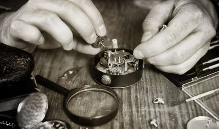 black and white photo watch clock repairing