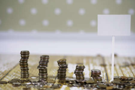 coins stacked in piles on the floor