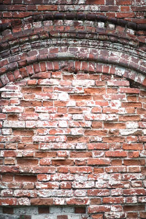 Old brick wall with a crack