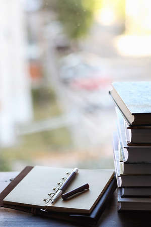 A stack of textbooks on the windowsill Stock Photo