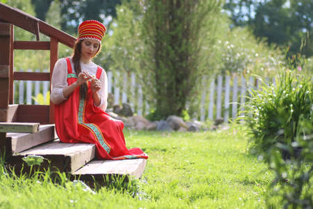 Slav woman in dress traditional Stock Photo