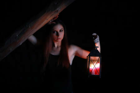 beautiful girl with red hair with a lantern Stock Photo