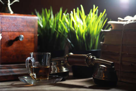 Brewing tea on a wooden table in the morning