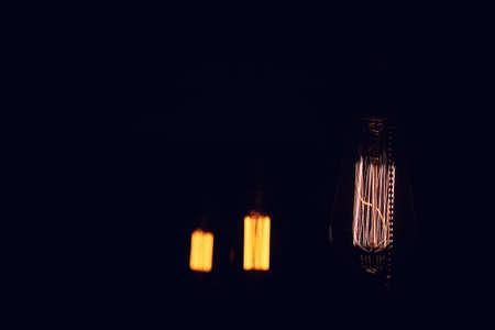 Lamps with tungsten filament. Edison light bulb. Filament filament in vintage lamps. Retro design of light bulbs.