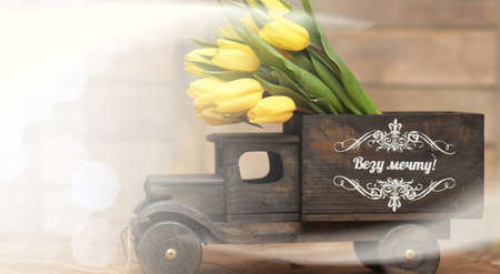 Bouquet of yellow tulips in a vase on floor