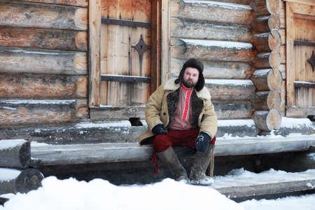 Traditional winter costume of peasant medieval age in Russia Foto de archivo