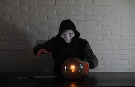 A man with a fortune teller ball
