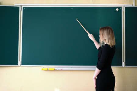 Young teacher in school class