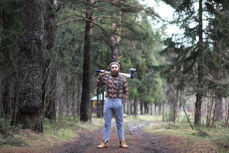 A bearded lumberjack with a large ax Фото со стока