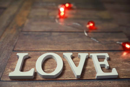 word Love from wooden letters on a wood background Reklamní fotografie
