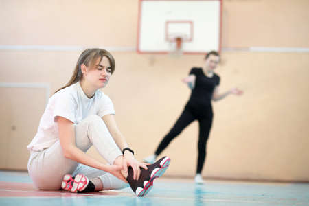 Girl in the gym playing a basketball