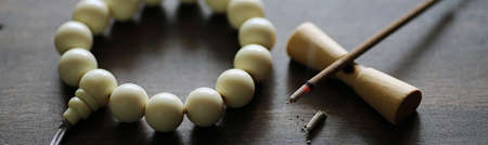 beads bracelet and Incense on the table