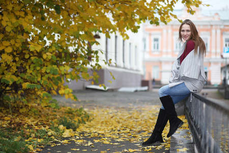 Young girl on a walk in the autumn park