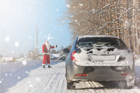 Santa Claus comes with gifts from the outdoor. Stock Photo