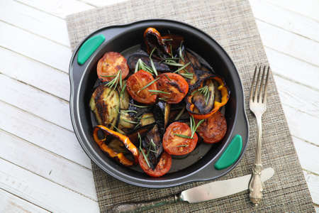 Summer vegetables grilled pan fried eggplant and tomatoes Stock Photo